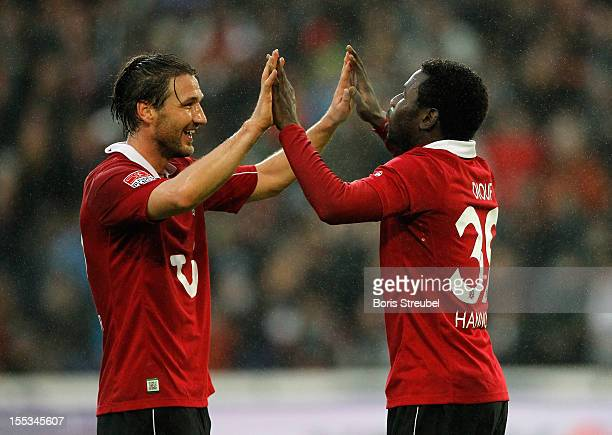 Mame Biram Diouf of Hannover celebrates after scoring his team's first goal with his team mate Christian Schulz during the Bundesliga match between...
