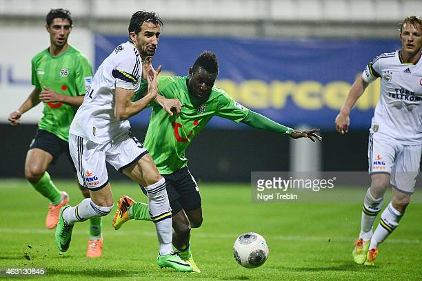 Mame Biram Diouf of Hannover is challenged by Bruno Alves of Fenerbahce SK during the friendly match between Fenerbahce SK and Hannover 96 at Mardan...