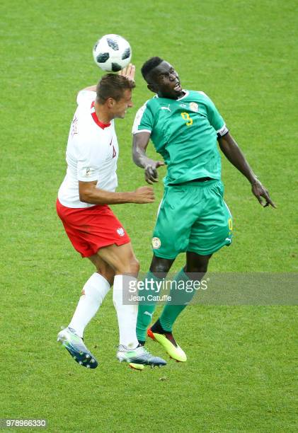 Mame Biram Diouf of Senegal Thiago Cionek of Poland during the 2018 FIFA World Cup Russia group H match between Poland and Senegal at Spartak Stadium...