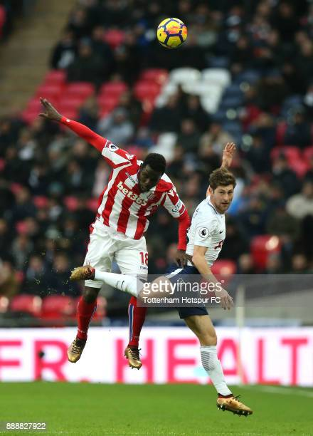 Mame Biram Diouf of Stoke City and Ben Davies of Tottenham Hotspur compete for a header during the Premier League match between Tottenham Hotspur and...
