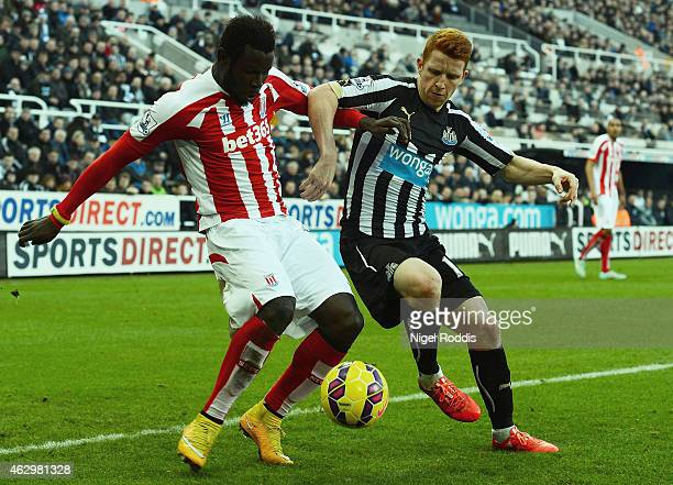 Mame Biram Diouf of Stoke City and Jack Colback of Newcastle United battle for the ball during the Barclays Premier League match between Newcastle...