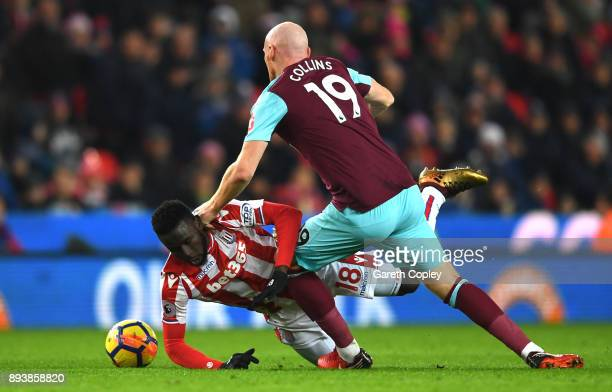 Mame Biram Diouf of Stoke City and James Collins of West Ham United battle for possession during the Premier League match between Stoke City and West...