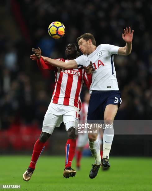 Mame Biram Diouf of Stoke City and Jan Vertonghen of Tottenham Hotspur contest for a header during the Premier League match between Tottenham Hotspur...