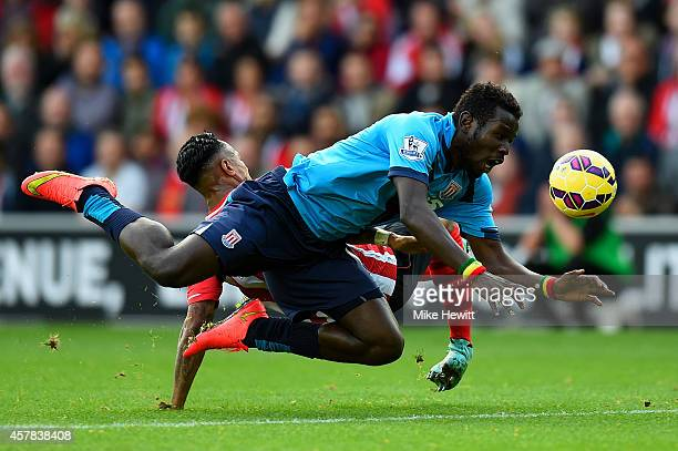 Mame Biram Diouf of Stoke City battles for the ball with Nathaniel Clyne of Southampton during the Barclays Premier League match between Southampton...