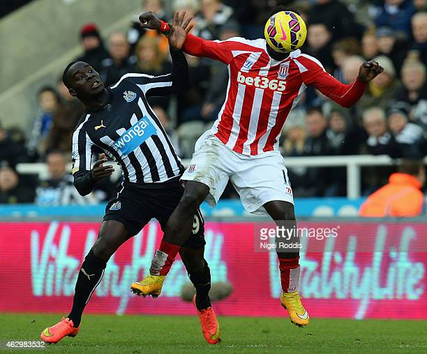Mame Biram Diouf of Stoke City beats Massadio Haidara of Newcastle United to the ball 18s 19n during the Barclays Premier League match between...