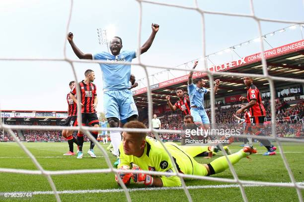 Mame Biram Diouf of Stoke City celebrates after Lys Mousset of AFC Bournemouth scores a own goal for Stoke City's first goal during the Premier...