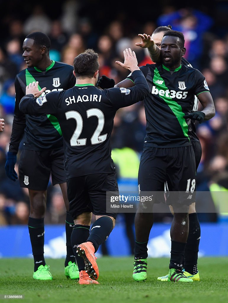 Mame Biram Diouf (1st R) of Stoke City celebrates scoring his team's first goal with his team mates during the Barclays Premier League match between Chelsea and Stoke City at Stamford Bridge on March 5, 2016 in London, England.