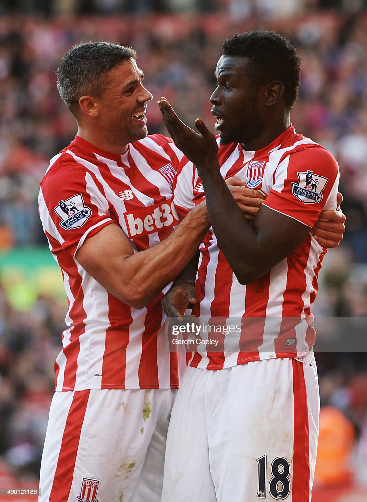 Mame Biram Diouf (R) of Stoke City celebrates scoring his team's second goal with his team mate Jonathan Walters (L) during the Barclays Premier League match between Stoke City and A.F.C. Bournemouth at Britannia Stadium on September 26, 2015 in Stoke on Trent, United Kingdom.