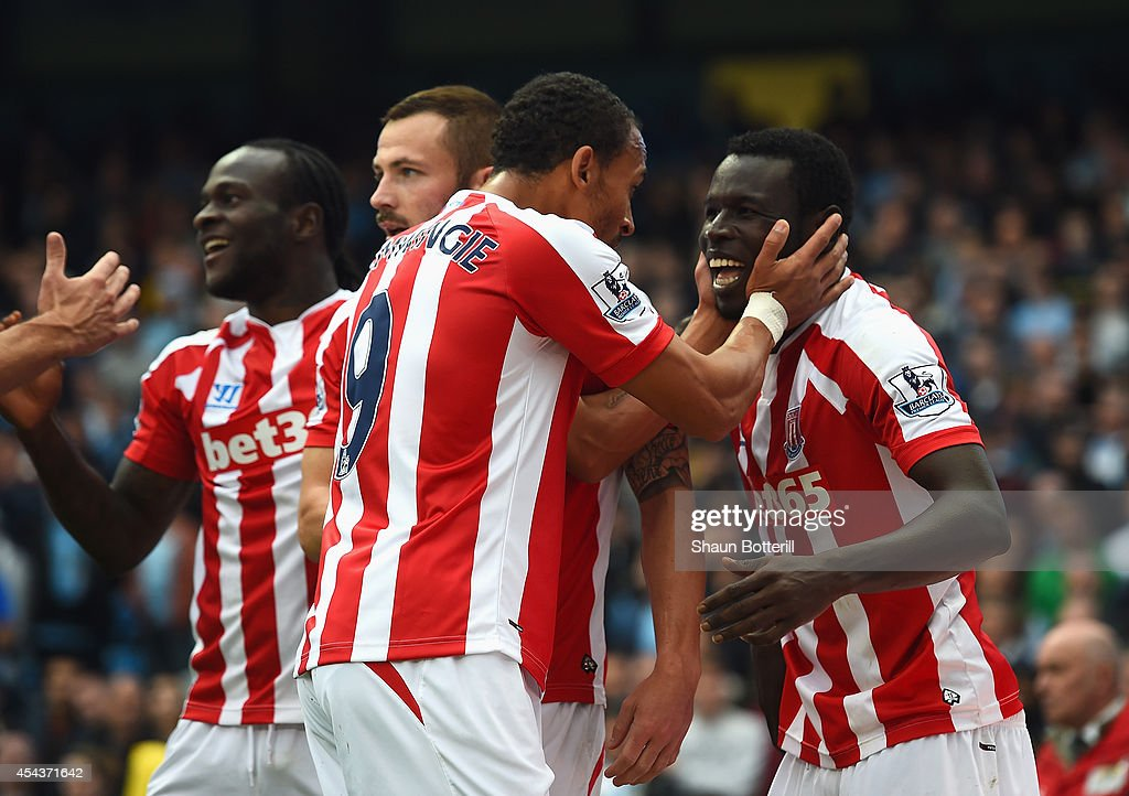 Mame Biram Diouf (R) of Stoke City celebrates scoring the opening goal with team mates during the Barclays Premier League match between Manchester City and Stoke City at Etihad Stadium on August 30, 2014 in Manchester, England.