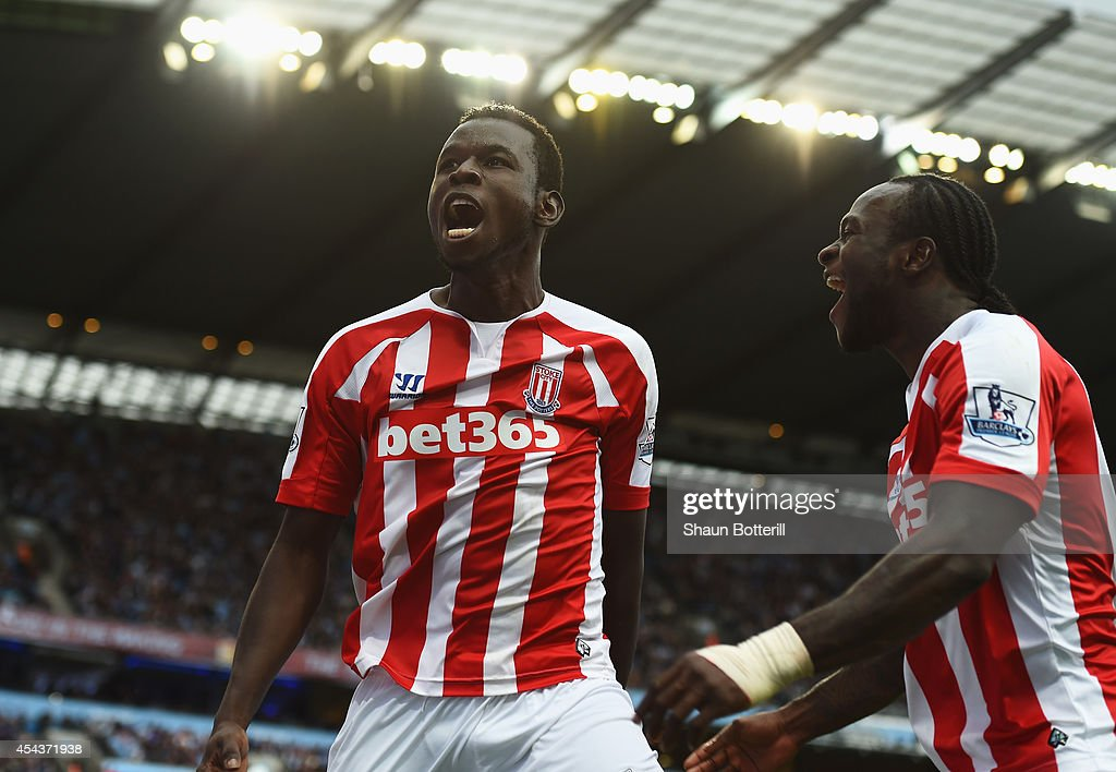 Mame Biram Diouf (L) of Stoke City celebrates scoring the opening goal during the Barclays Premier League match between Manchester City and Stoke City at Etihad Stadium on August 30, 2014 in Manchester, England.