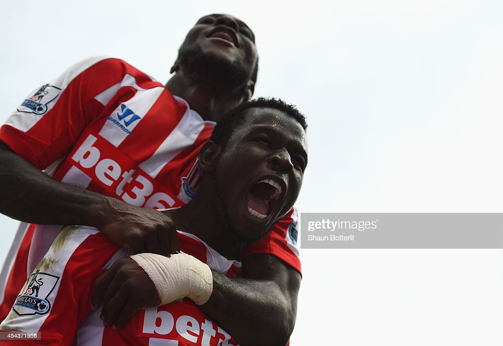Mame Biram Diouf (R) of Stoke City celebrates scoring the opening goal during the Barclays Premier League match between Manchester City and Stoke City at Etihad Stadium on August 30, 2014 in Manchester, England.