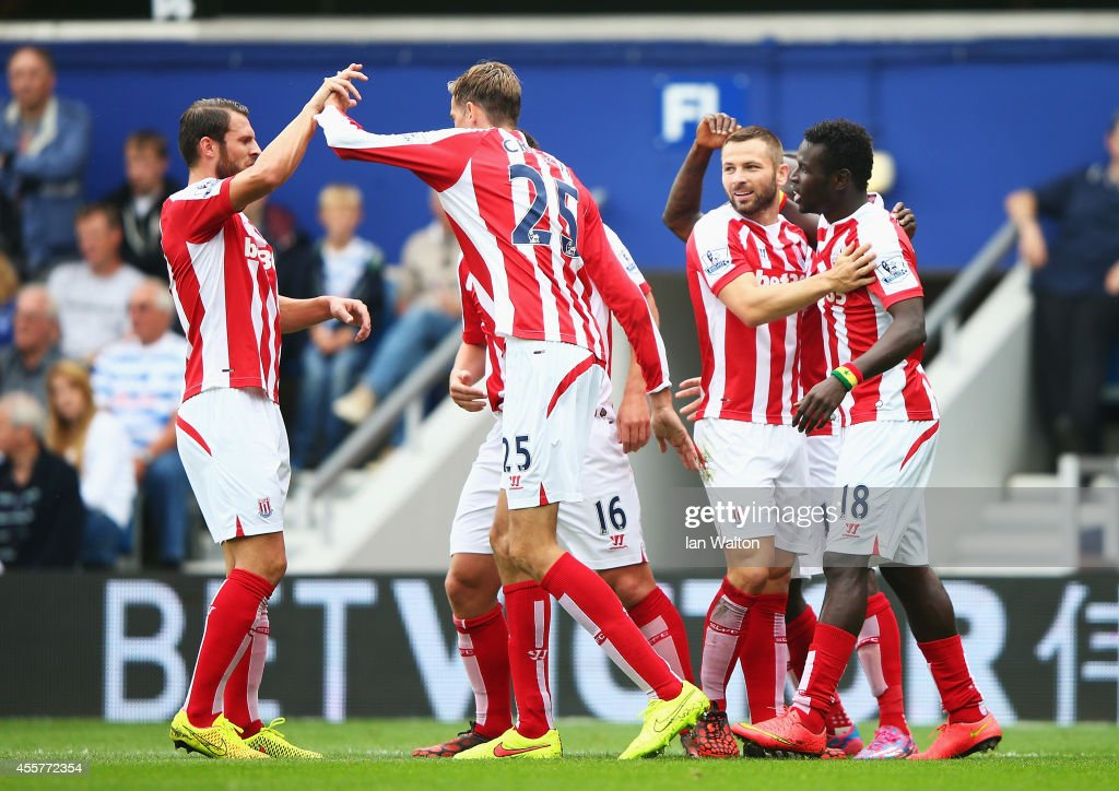 Mame Biram Diouf (R) of Stoke City celebrates scoring the opening goal with team mates during the Barclays Premier League match between Queens Park Rangers and Stoke City at Loftus Road on September 20, 2014 in London, England.