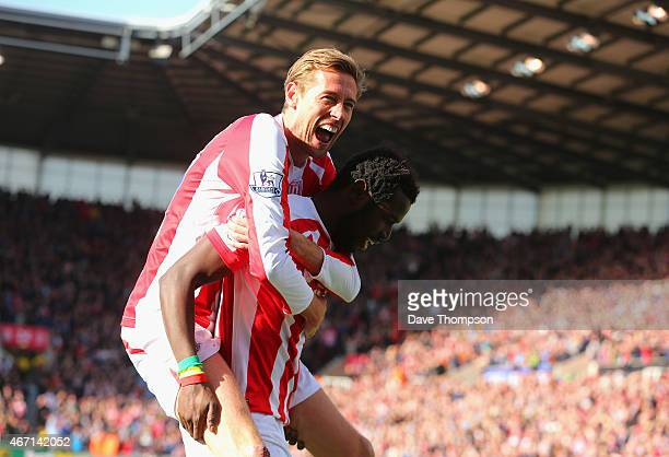 Mame Biram Diouf of Stoke City celebrates scoring the opening goal with Peter Crouch during the Barclays Premier League match between Stoke City and...