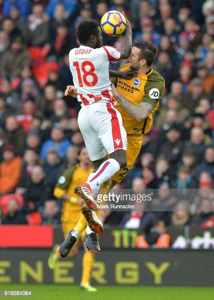 Mame Biram Diouf of Stoke City competes for a header with Shane Duffy of Brighton and Hove Albion during the Premier League match between Stoke City...