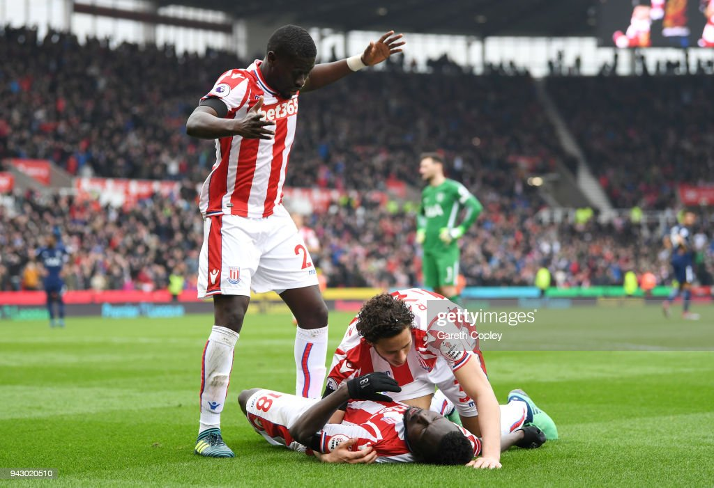 Mame Biram Diouf of Stoke City goes down injured after scoring his sides first goal during the Premier League match between Stoke City and Tottenham Hotspur at Bet365 Stadium on April 7, 2018 in Stoke on Trent, England.