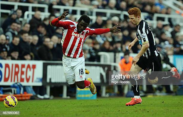 Mame Biram Diouf of Stoke City is challenged by Jack Colback of Newcastle United during the Barclays Premier League match between Newcastle United...