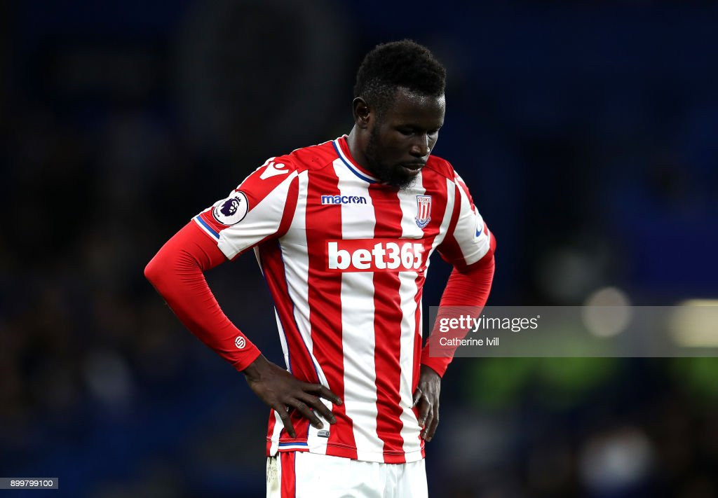 Mame Biram Diouf of Stoke City looks dejected during the Premier League match between Chelsea and Stoke City at Stamford Bridge on December 30, 2017 in London, England.