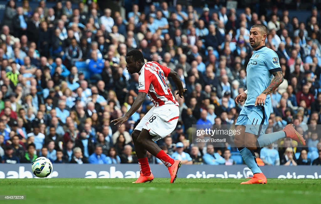 Mame Biram Diouf of Stoke City scores his goal during the Barclays Premier League match between Manchester City and Stoke City at Etihad Stadium on August 30, 2014 in Manchester, England.