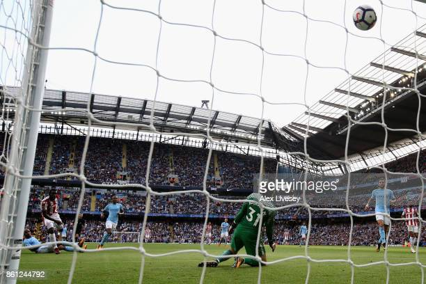 Mame Biram Diouf of Stoke City scores his sides first goal during the Premier League match between Manchester City and Stoke City at Etihad Stadium...