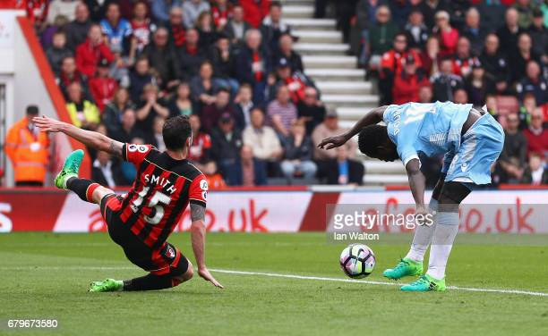 Mame Biram Diouf of Stoke City scores his sides second goal as Adam Smith of AFC Bournemouth attempts to block during the Premier League match...