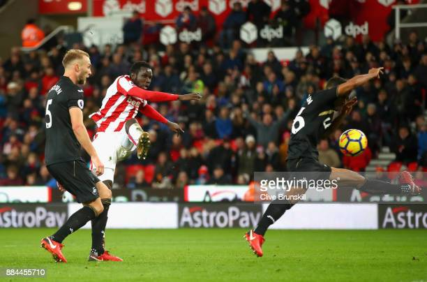Mame Biram Diouf of Stoke City scores his sides second goal during the Premier League match between Stoke City and Swansea City at Bet365 Stadium on...