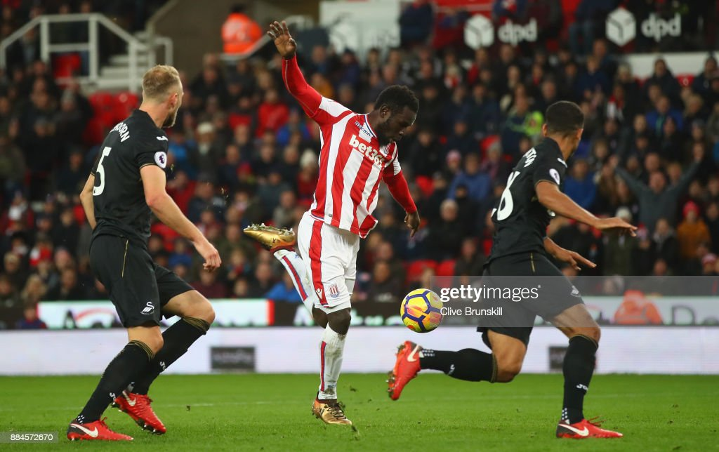 Mame Biram Diouf of Stoke City scores his sides second goal during the Premier League match between Stoke City and Swansea City at Bet365 Stadium on December 2, 2017 in Stoke on Trent, England.