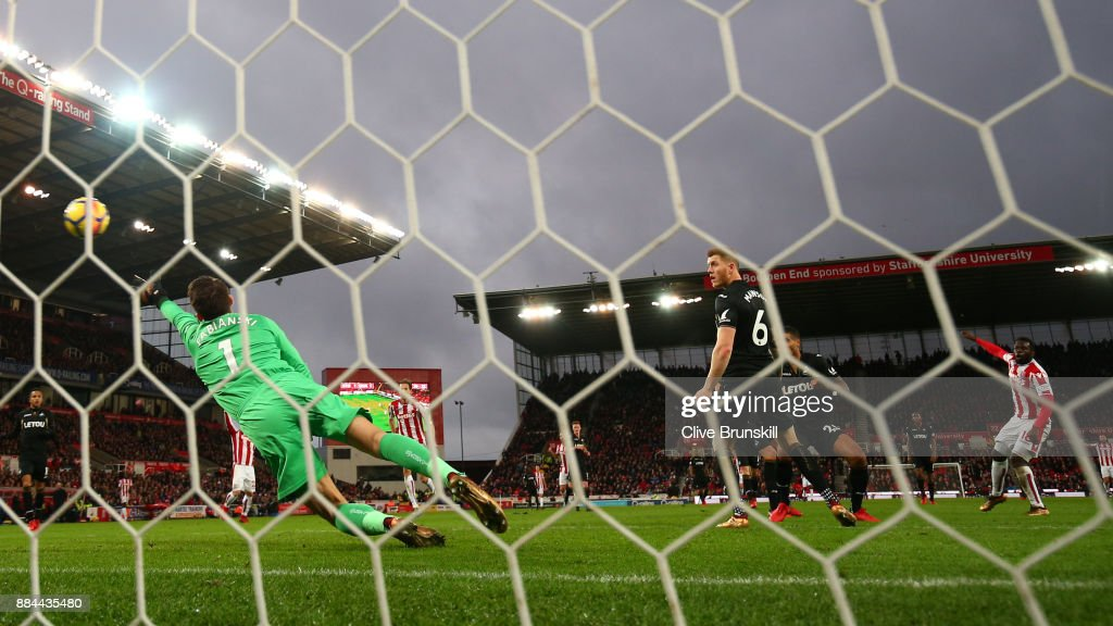 Mame Biram Diouf of Stoke City scores his sides second goal past Lukasz Fabianski of Swansea City during the Premier League match between Stoke City and Swansea City at Bet365 Stadium on December 2, 2017 in Stoke on Trent, England.