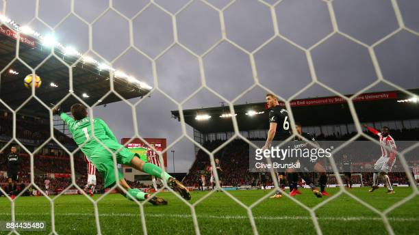 Mame Biram Diouf of Stoke City scores his sides second goal past Lukasz Fabianski of Swansea City during the Premier League match between Stoke City...