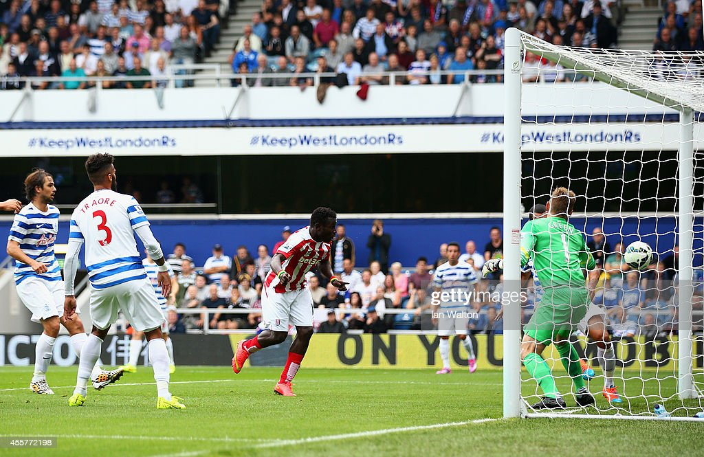 Mame Biram Diouf of Stoke City scores the opening goal during the Barclays Premier League match between Queens Park Rangers and Stoke City at Loftus Road on September 20, 2014 in London, England.