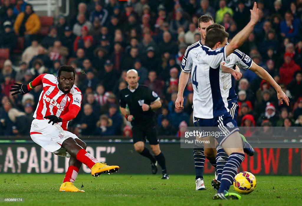 Mame Biram Diouf of Stoke City (L) scores their first goal during the Barclays Premier League match between Stoke City and West Bromwich Albion at Britannia Stadium on December 28, 2014 in Stoke on Trent, England.