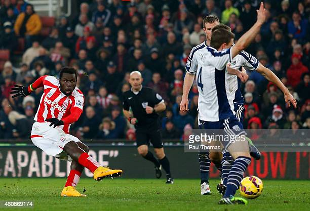 Mame Biram Diouf of Stoke City scores their first goal during the Barclays Premier League match between Stoke City and West Bromwich Albion at...