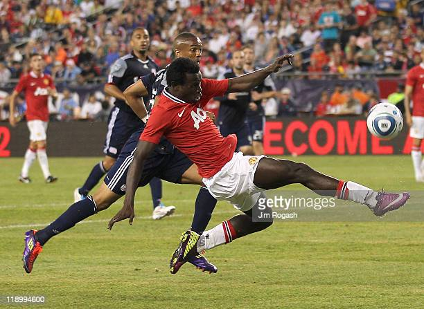 Mame Biram Diouf of the Manchester United shoots on net against the defense Darrius Barnes of the New England Revolution during a friendly match at...