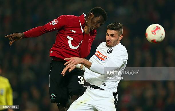 Mame Diouf of Hannover and Daniel Caligiuri of Freiburg battle for the ball during the Bundesliga match between Hannover 96 and SC Freiburg at AWD...