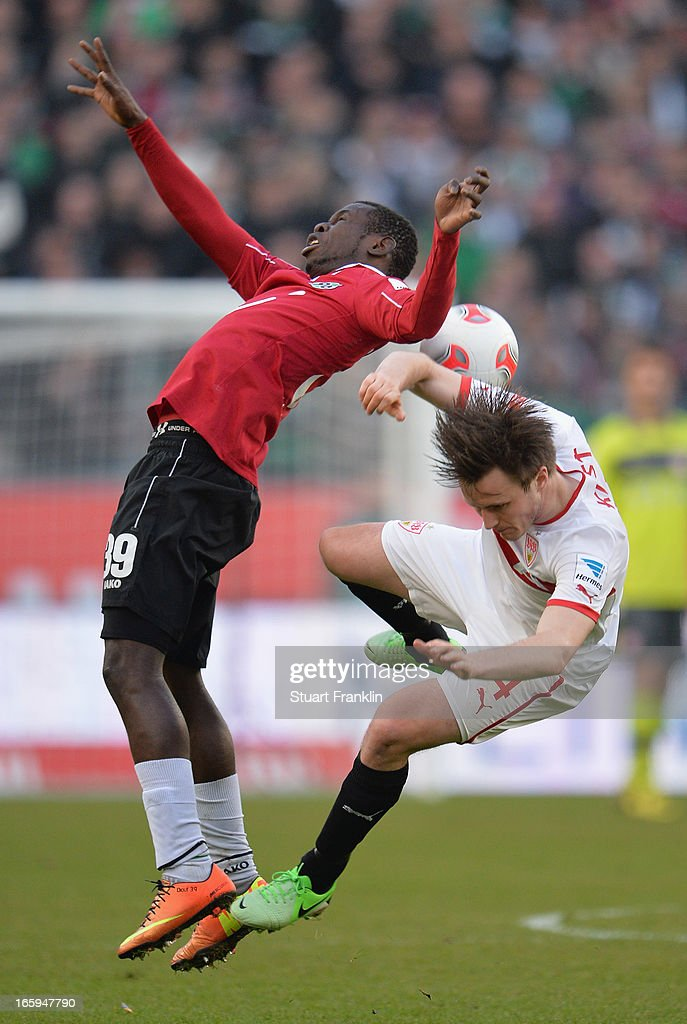 Mame Diouf of Hannover is challenged by William Kvist of Stuttgart during the Bundesliga match between Hannover 96 v VfB Stuttgart at AWD Arena on April 7, 2013 in Hannover, Germany.