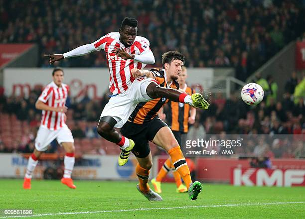 Mame Diouf of Stoke City and Harry Maguire of Hull City during the EFL Cup Third Round match between Stoke City and Hull City at Bet365 Stadium on...
