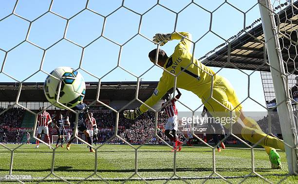 Mame Diouf of Stoke Ciy scores his team's first goal during the Barclays Premier League match between Stoke City and Southampton at the Britannia...