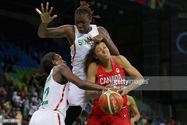 Mame Marie Sy and Maimouna Diarra of Senegal strip the ball from Nayo RaincockEkunwe of Canada in the Women's Basketball Preliminary Round Group B...