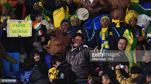 Mamelodi Sundowns fans sing prior to the FIFA Club World Cup second round match between Mamelodi Sundowns and Kashima Antlers at Suita City Football...