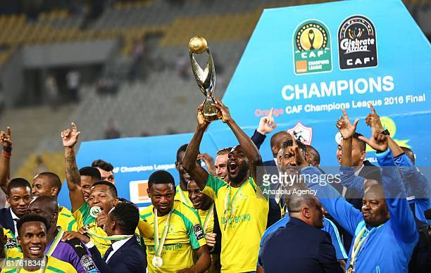 Mamelodi Sundowns FC players pose with the trophy after the CAF Champions League final football match between Zamalek and Mamelodi Sundowns on...