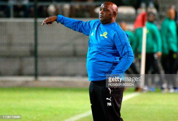 Mamelodi Sundown's head coach, Pitso Mosimane gestures as he looks on from the touchline during the Premier Soccer League football match between Cape...