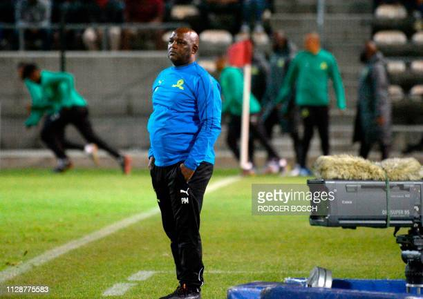 Mamelodi Sundown's head coach Pitso Mosimane looks on from the touchline during the Premier Soccer League football match between Cape Town City and...