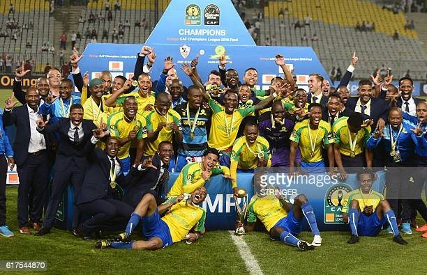 Mamelodi Sundowns' players celebrate after winning the CAF Champions League football competition following the final match against Egypt's Zamalek on...