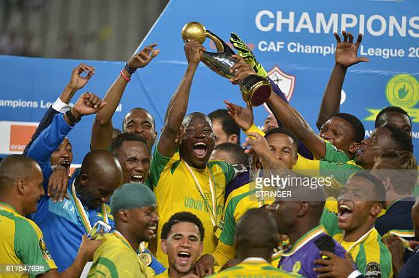 Mamelodi Sundowns' players celebrate with the trophy after winning the CAF Champions League football competition following the final match against...