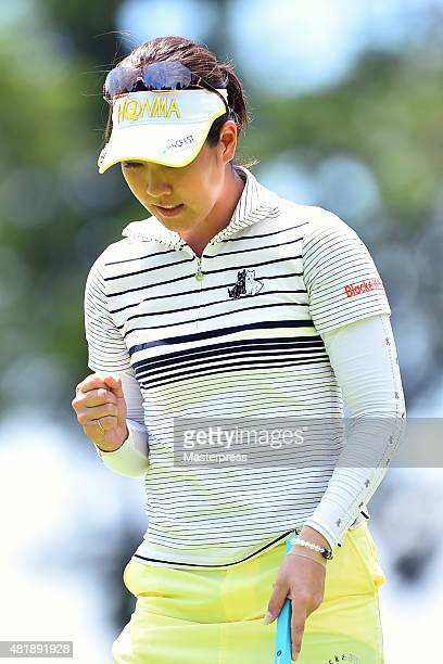 Mami Fukuda of Japan celebrates after making her birdie putt on the 9th hole during the second round of the Century 21 Ladies Golf Tournament 2015 at...