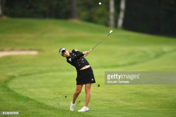 Mami Fukuda of Japan hits her second shot on the 11th hole during the first round of the 50th LPGA Championship Konica Minolta Cup 2017 at the Appi...