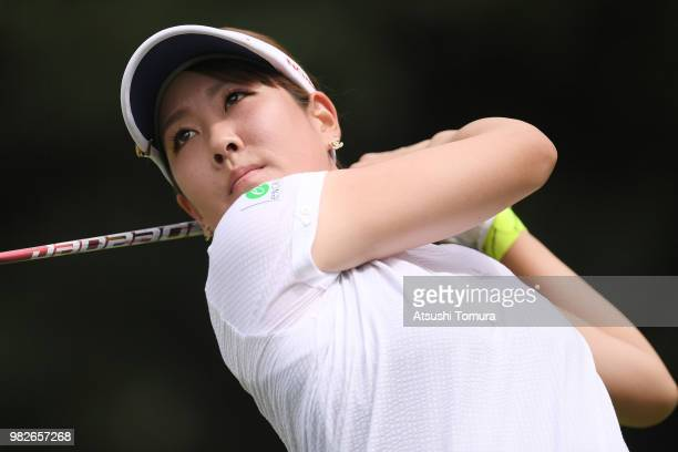 Mami Fukuda of Japan hits her tee shot on the 14th hole during the final round of the Earth Mondahmin Cup at the Camellia Hills Country Club on June...