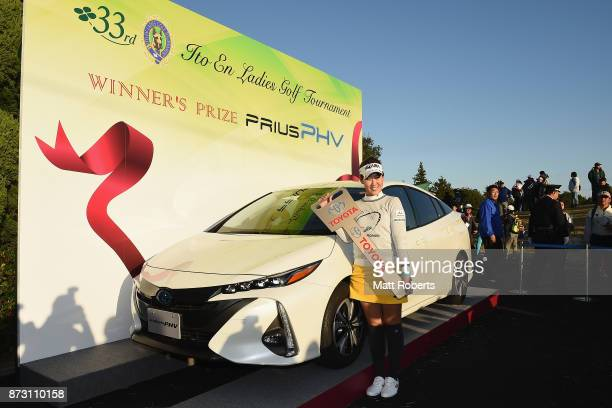 Mami Fukuda of Japan poses for photographs after winning the Itoen Ladies Golf Tournament 2017 at the Great Island Club on November 12 2017 in Chonan...
