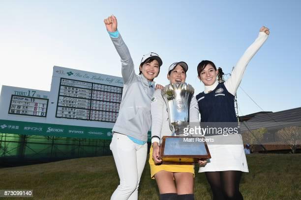 Mami Fukuda of Japan poses with Rumi Yoshiba and Kotono Kozuma of Japan after the final round of the Itoen Ladies Golf Tournament 2017 at the Great...