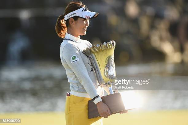 Mami Fukuda of Japan poses with the trophy after winning the Itoen Ladies Golf Tournament 2017 at the Great Island Club on November 12 2017 in Chonan...