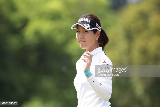 Mami Fukuda of Japan reacts after a putt on the 18th green during the final round of the Chukyo Television Bridgestone Ladies Open at the Chukyo Golf...